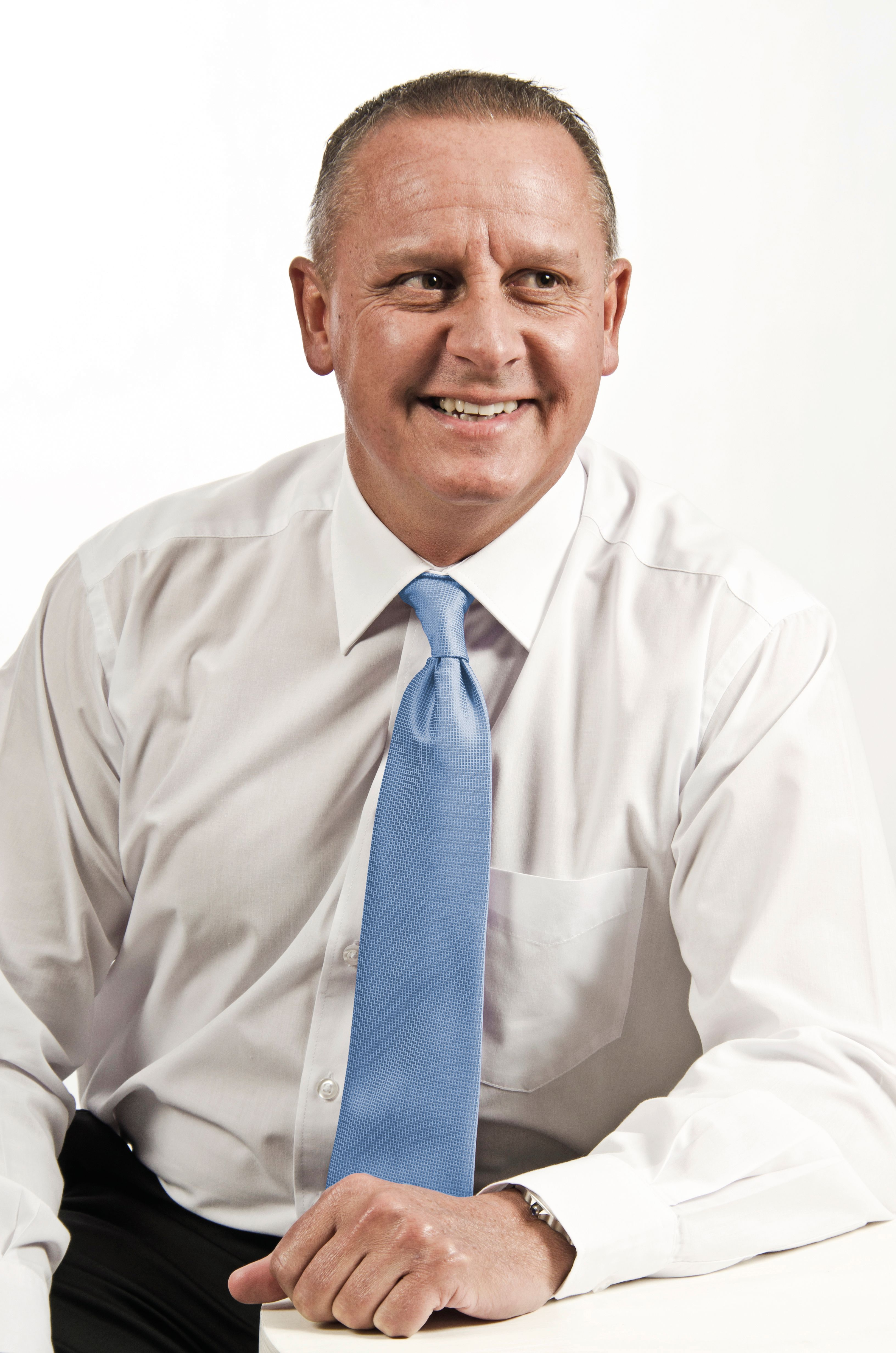 Phil Roux with blue tie