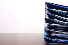 A pile of files on a desk