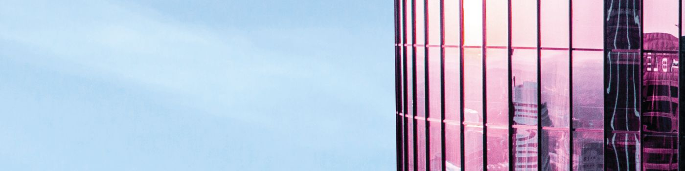 Pink glass building with blue sky