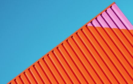 Pink and red roof against a blue sky