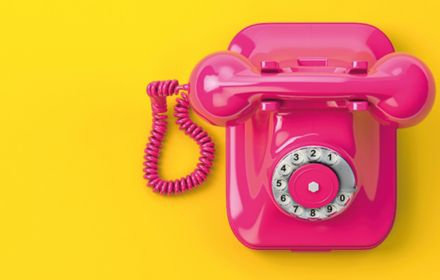 pink-telephone-on-yellow-background