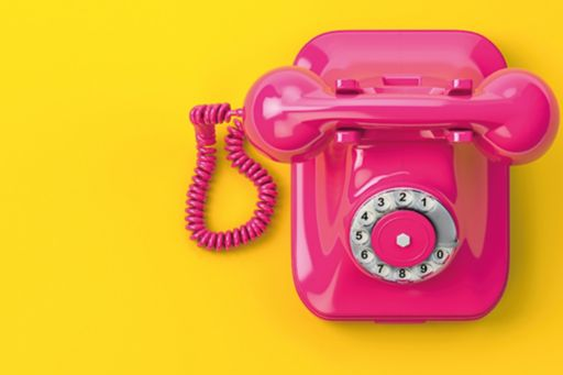 Pink and yellow telephone