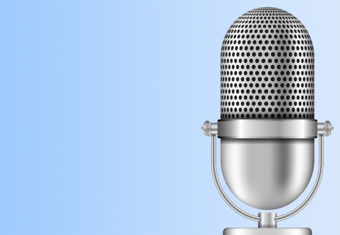 Podcast mic with light blue background