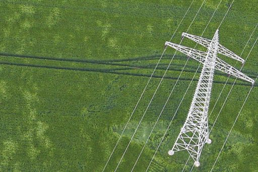 Power lines over a green field