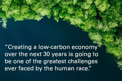 """Forrest, with text overlaid """"Creating a low-carbon economy over the next 30 years is going to be one of the greatest challenges ever faced by the human race"""""""