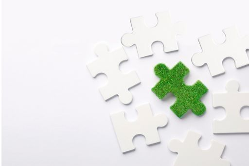 puzzle piece made of green grass