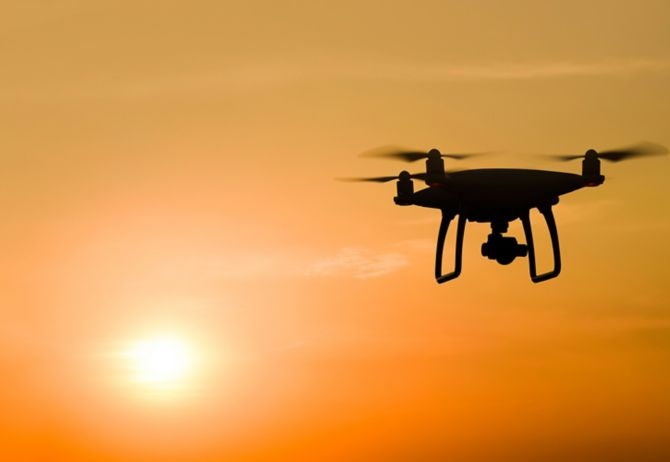 Quadrocopter's silhouette against the background of the sunset
