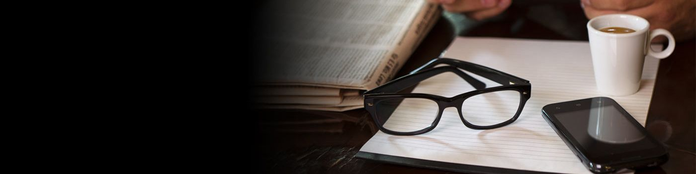Reading news on a tablet with glasses