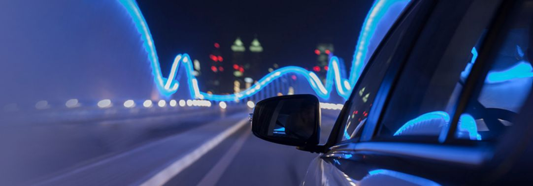 Rear view mirror of a car travelling on bridge