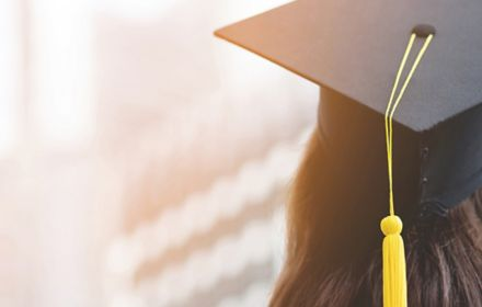 Rear view of a college graduate girl