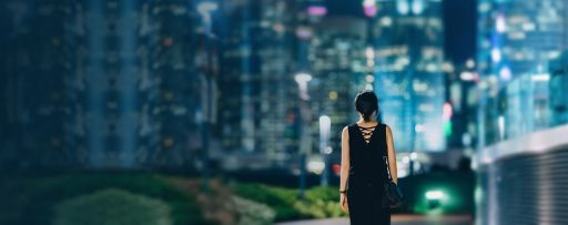 Rear view of a woman looking towards Hong Kong's business district