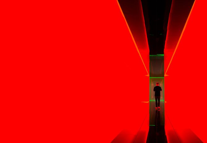 Red balck walls man standing