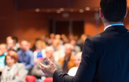 Speaker in front of an audience