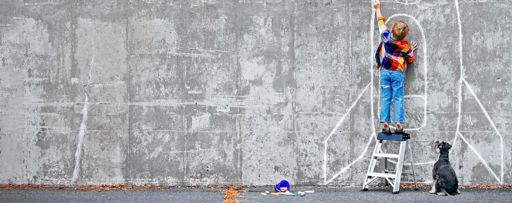 Reimagine Challenge 2019 - photo of a child drawing a rocket on the wall