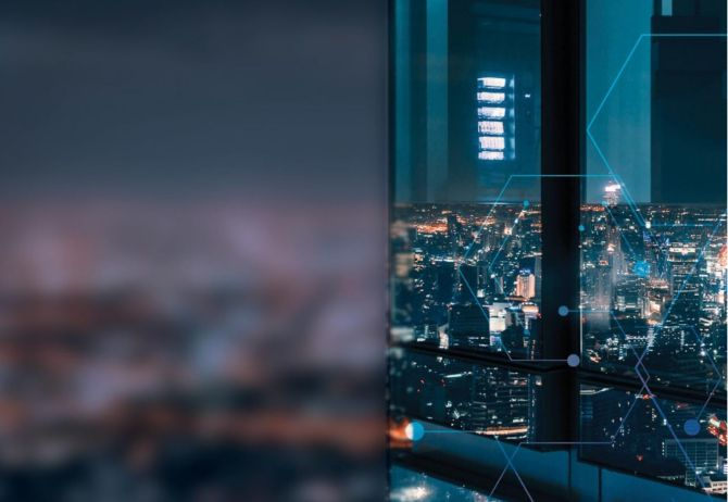 City view at night from a high rise office glass building