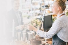 Retail assistant serving customer