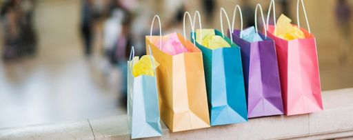 KPMG IFRS revenue topic image: colourful shopping bags on a platform