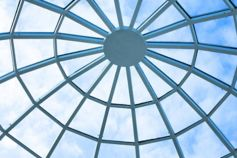 Looking up through an arched glass roof