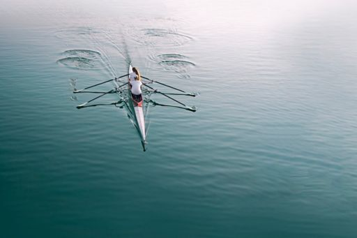 Rowing boat in middle of sea