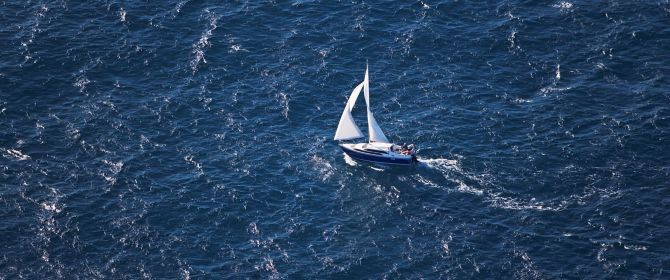 Sail boal sailing in middle of sea