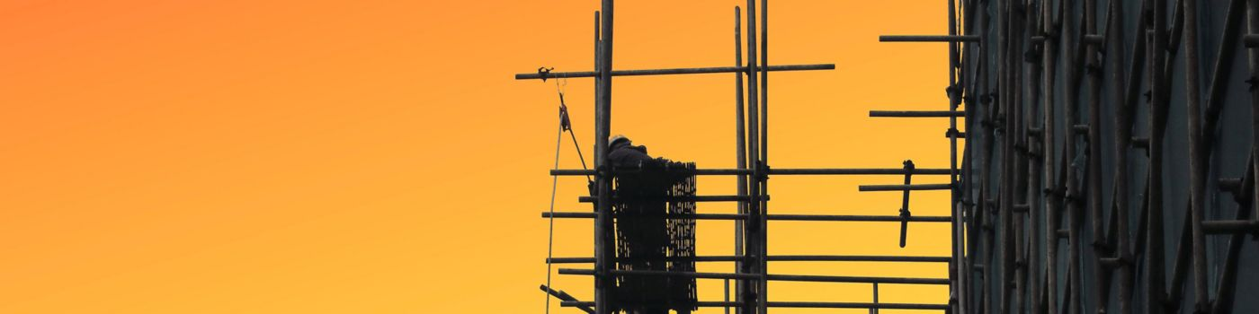 Scaffolding construction pipes sunset