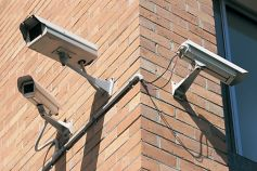 Security safety camera on brick wall