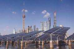 Solar panels against backdrop of Shanghai