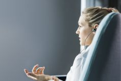Side view of a business women talking on earphones