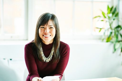 Smiling business woman sits in a meeting room