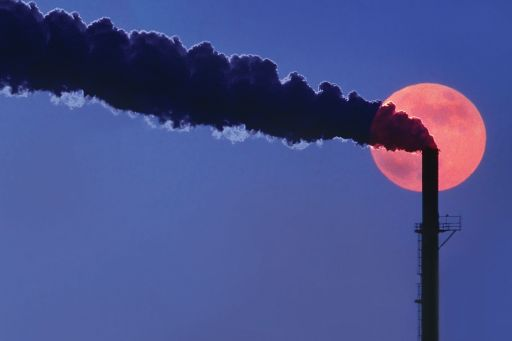 Smoke coming out of chimney in night under moonlight