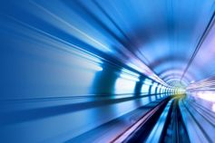Look Back Face Forward: 2020 Real Estate trends - subway-tunnel-with-blue-and-white-lights-on-both-sides