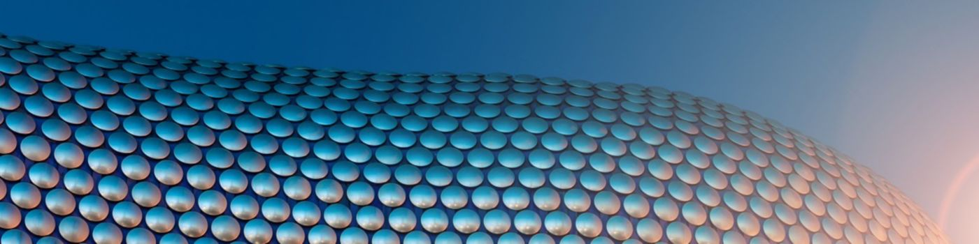 Sunlight on building with circular discs pattern