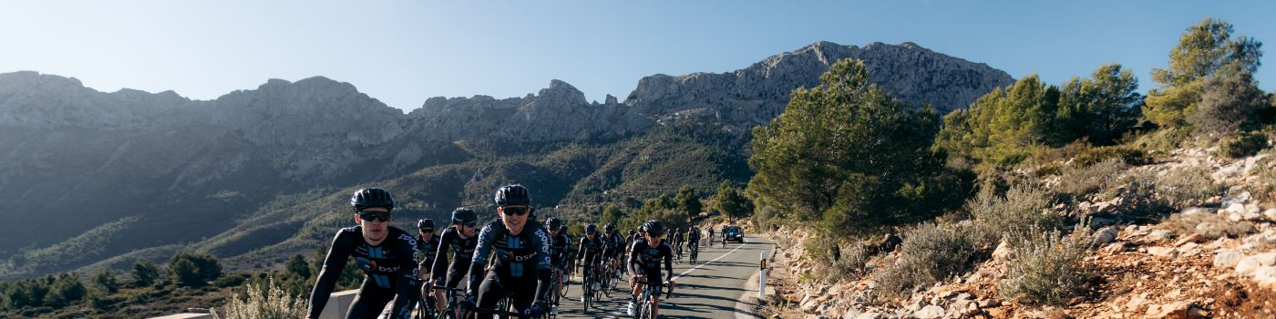 Bicycle racers team dsm racing mountains background