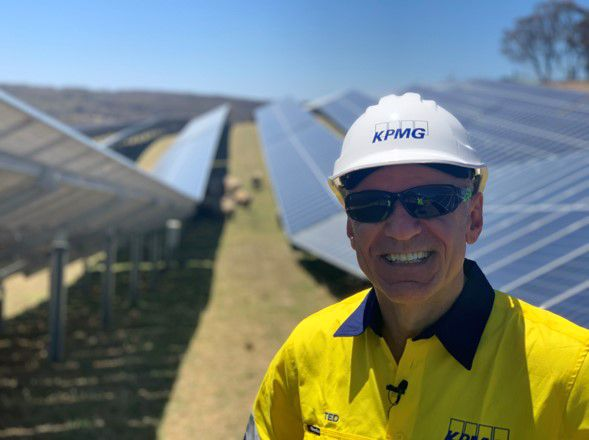 Ted Surette, KPMG Australia, visiting a local wind and solar farm.