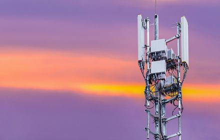 Telecommunication tower against evening sky