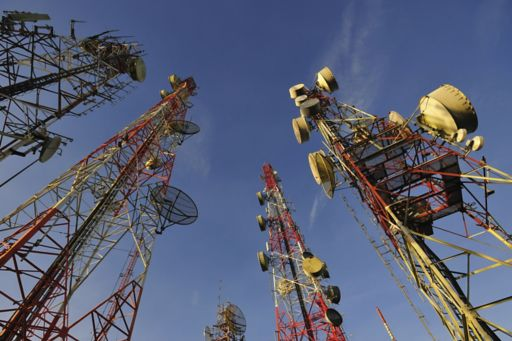 Telecommunication towers against blue sky