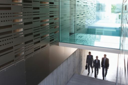 three business people in staircase