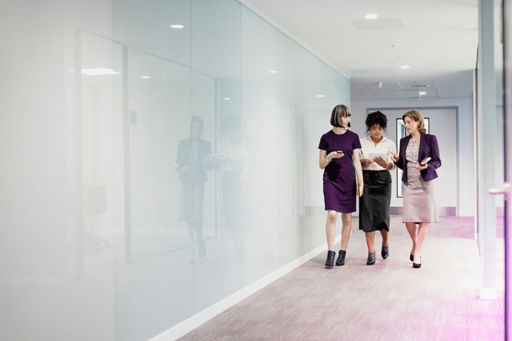 Operations consulting - Three women discussing while walking