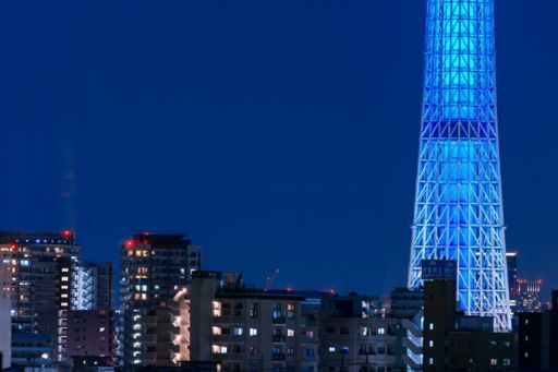Tokyo blue glass building at night