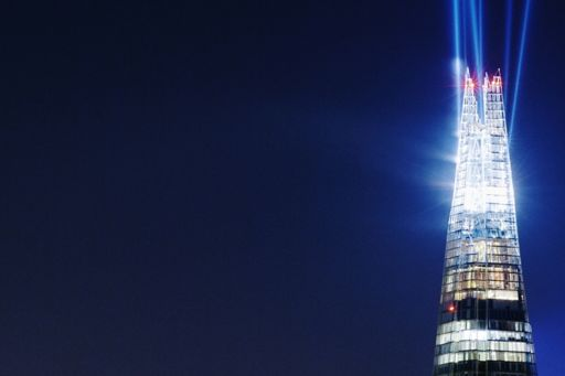 Top of lighted glass building at night