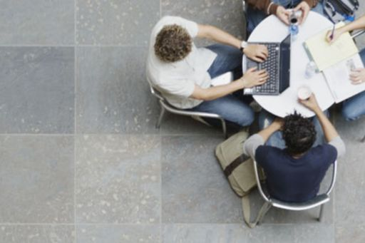People working at a circular table