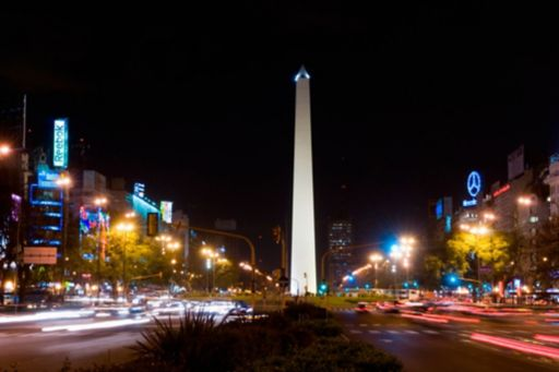 traffic in motion around the Obelisk at night