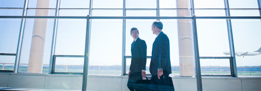 two businessmen walking in airport