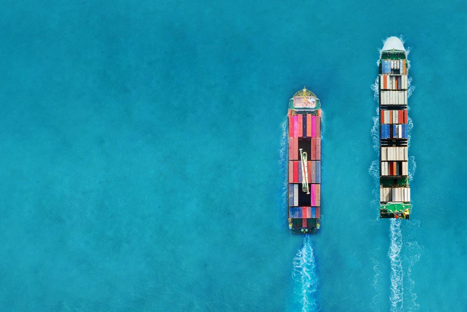 two cargo vessels sailing at sea