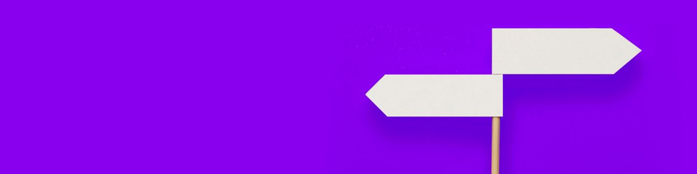 Two-directional sign on purple background