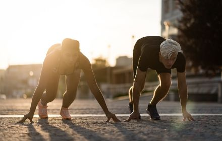 Two runners getting ready for a sprint