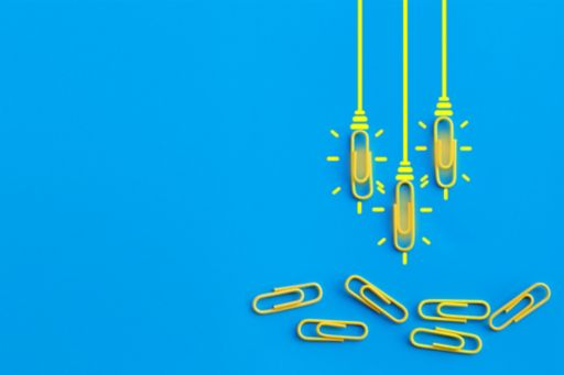 blue-background-yellow-paper-clip-light-bulb