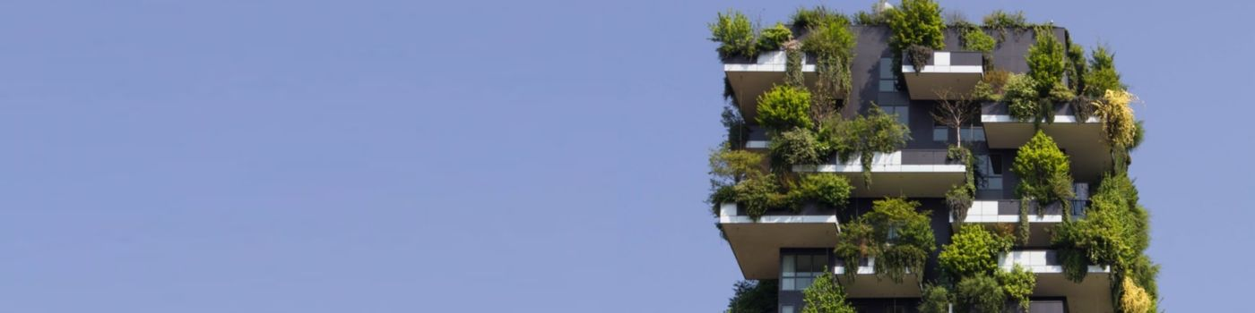 Modern apartment building with plants on balconies