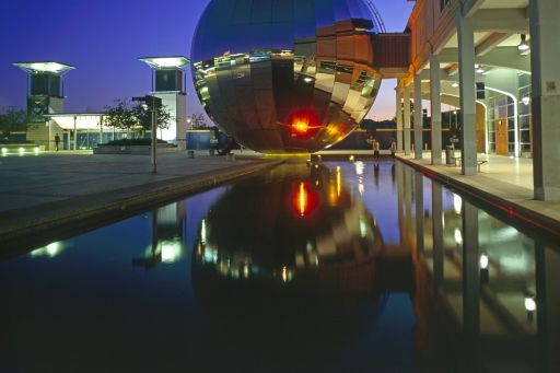 View of a round shaped glass structure near a pool