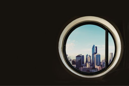 View of buildings from circular window